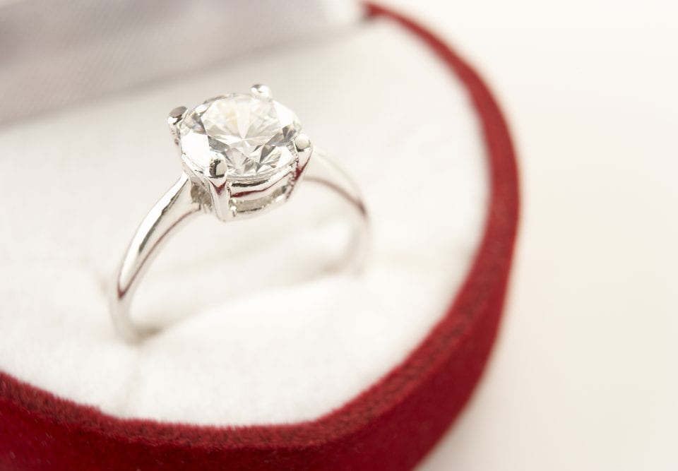 east-west engagement ring setting
